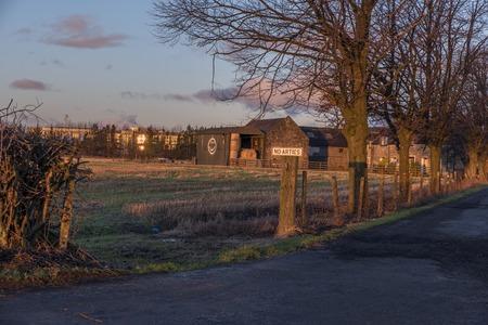 Shot of a sunrise over old Farm Stock Photo