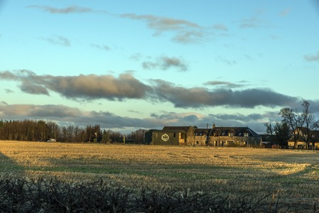 Shot of a sunrise over Farm House