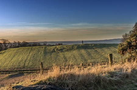 Shot of a beautiful Sunrise over Stirling field Stock Photo