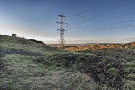 Shot of a Electricity pylons in Scottish Field
