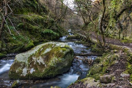 hydrological: Shot of a big Rock in Scottish river