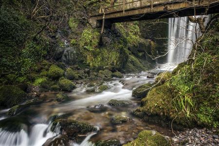 Waterfall under an old brigdge in Alva Geln Scotland