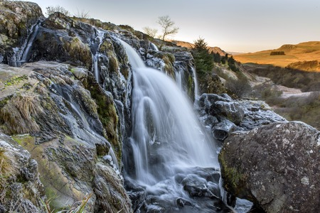Close view of the Loup of Fintry Waterfall at the River Endrick Stock Photo