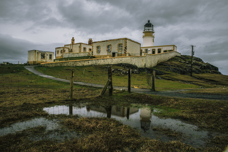 Dramatic shot of Neist Point Lighthouse in Skye