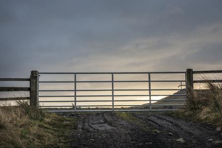 Sunrise behing a closed gate