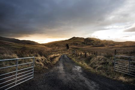 Open gate in a Scottish field