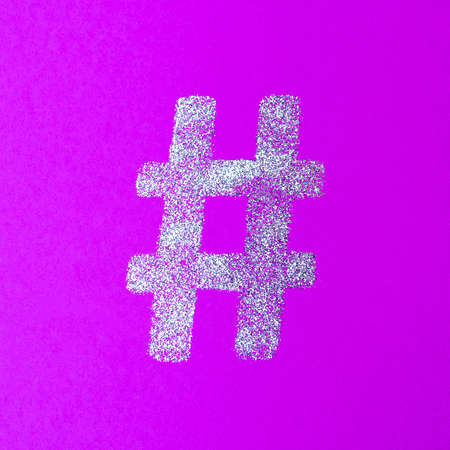 Hashtag sign. Silver hashtag symbol on lilac background