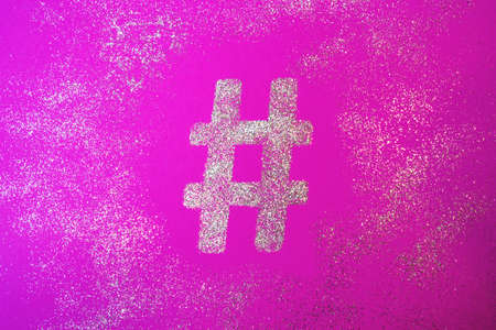 Hashtag sign. Silver hashtag symbol on trendy pink background