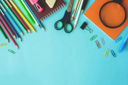School supplies on blue background. Top view. Copy space. 스톡 콘텐츠