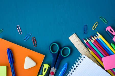 School supplies on blue background. Top view. Copy space. Imagens