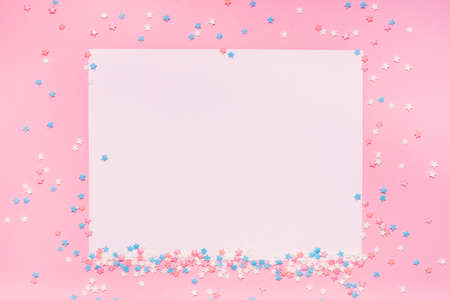 Little stars confetti on pink background. Holyday concept. Copy cpase for your text.