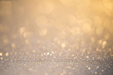 Silver glitter christmas abstract background. Defocused sequin light. Stock Photo