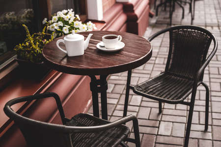 Street view of a summer terrace cafe with table and chairs. 스톡 콘텐츠