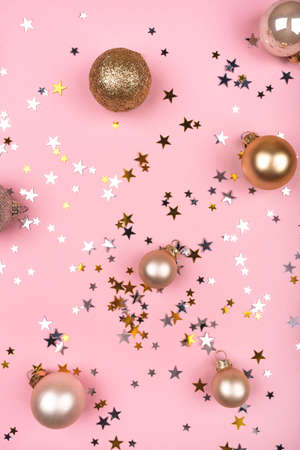 Festive pink background with gold and silver stars and Christmas balls. Flat lay, top view. Stock Photo