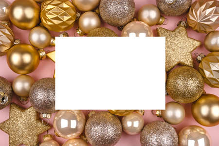 Festive pink background with gold and silver Christmas stars and balls. Flat lay, top view. Copy space for your text.