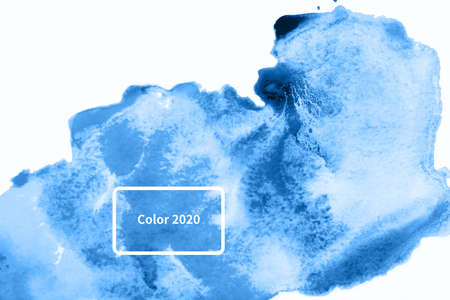 Abstract watercolor background with blue stains. Color of year 2020.