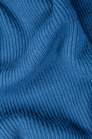 Blue knitted fabric texture for your background. Main color of year 2020.