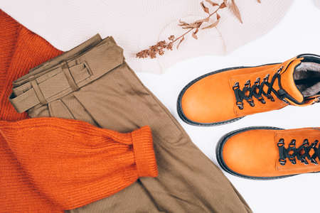 Warm clothes and boots on the table. Spring-Summer 2020 Colors. Flat lay.