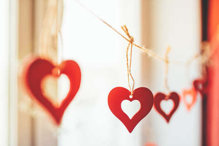 Decoration for Valentine's Day with ornaments in the form of hearts on a branch.