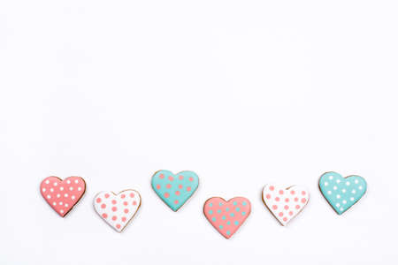 Gingerbread cookies with frosting in the shape of a heart. Valentines day concept. Flat lay, top view, copy space for text.