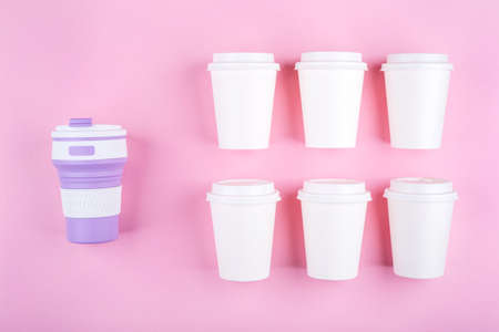 Reusable coffee cup vs disposable cups. Pink background. Zero waste concept.