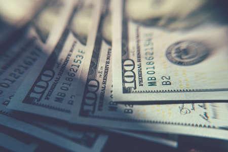 American cash dollars close-up. One Hundred Dollar Banknotes. Soft focus image.