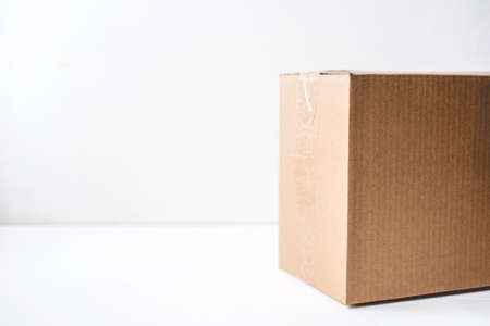Cardboard box on white background. Copy space for text.