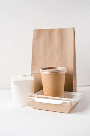 Various packaging for food delivery on white background.