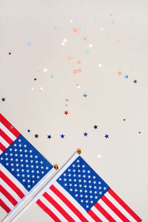 Festive background with US flags and confetti in the shape of stars. US independence day concept. Foto de archivo