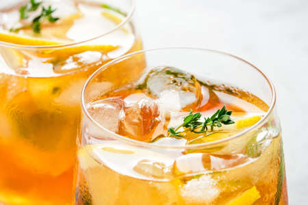 Iced tea with ice, mint and lemon. Refreshment cold summer drink. Close up shot.