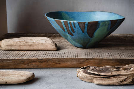 Handmade ceramics in the style of wabi sabi. Blue clay bowl with an abstract pattern. Stock Photo