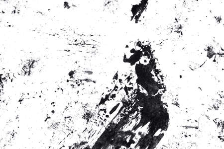 Abstract drops and smears of black acrylic paint isolated on a white background.