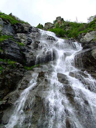 capra: Waterfall Capra river on Transfagarasan Road Stock Photo