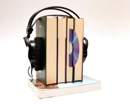 audio headphones and loading cd books with white background isolated photo