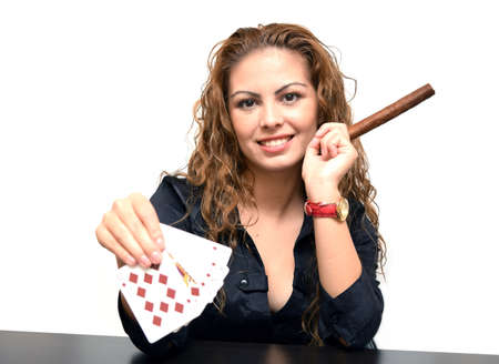 young girl showing poker card and smoke a cigar photo