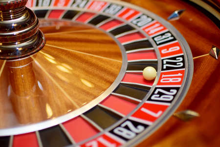 dependency: number eighteen at the roulette wheel in casino close up details