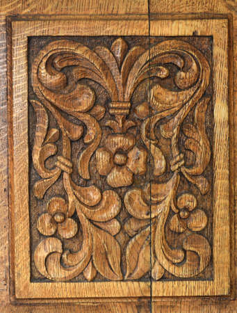 traditional door panel carved in wood at the old monastery Stock Photo