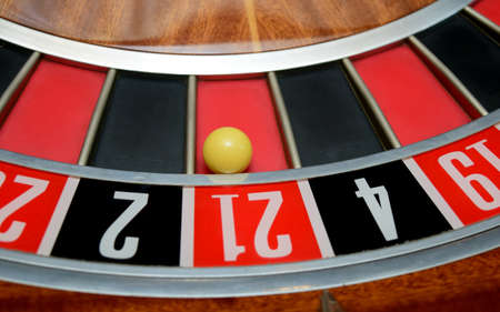 turning table: ball in winning number twenty one at roulette wheel