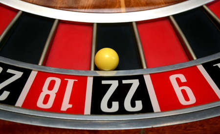 two wheel: ball in winning number twenty two at roulette wheel