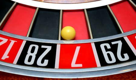 turning table: white ball in winning number seven roulette wheel