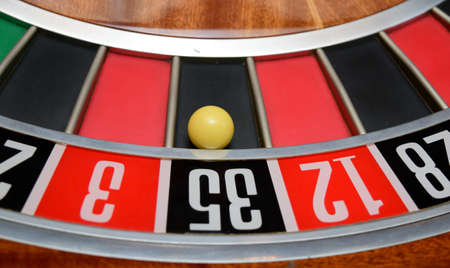 thirty five: ball in winning number thirty five at roulette wheel Stock Photo