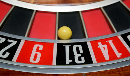 turning table: ball in winning number thirty one at roulette wheel Stock Photo