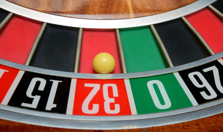 two wheel: ball in winning number thirty two at roulette wheel