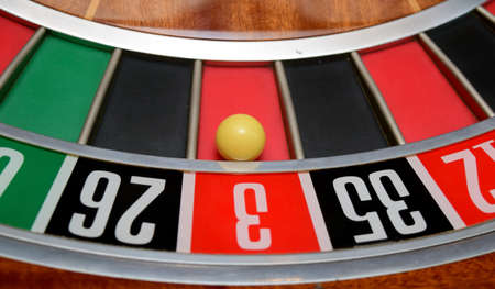three wheel: ball in winning number three at roulette wheel
