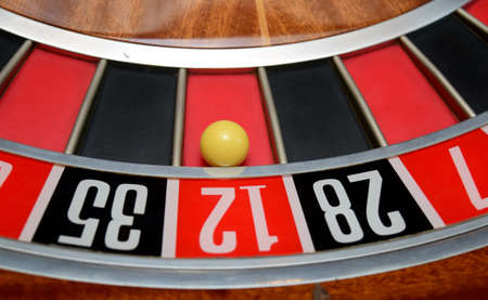 five to twelve: ball in winning number twelve at roulette wheel