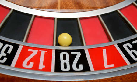 turning table: ball in winning number twenty eight at roulette wheel