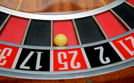 twenty five: ball in winning number twenty five at roulette wheel