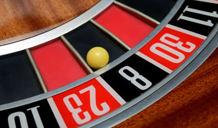 wheel spin: ball in winning number eight at roulette wheel Stock Photo