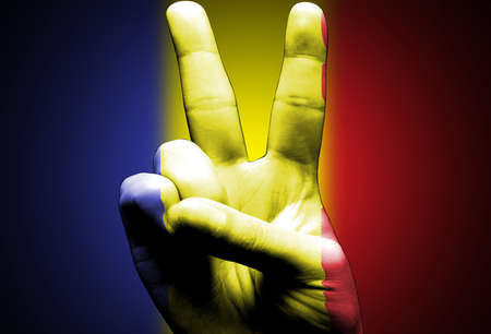 v sign hand painted with romanian flag over the romania flag black