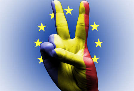 v sign hand painted with romanian flag over the european union flag white